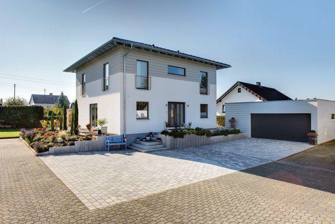 Stadtvilla bravur 400 von fingerhaus for Haus mit doppelgarage bauen
