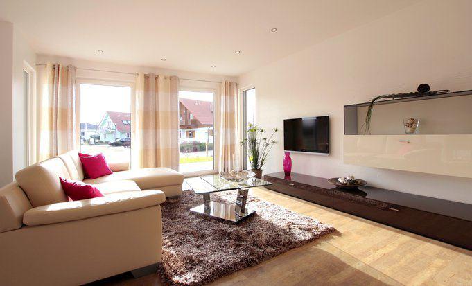 house-2192-wohnzimmer-im-fertighaus-ventura-von-rensch-haus-1
