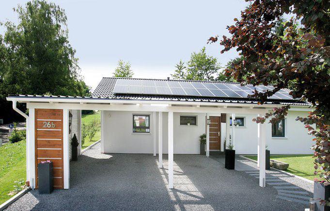 house-2748-der-carport-greift-das-design-der-terrassenpergola-auf-das-dekorelement-hinter-dem-die-muelltonne-2